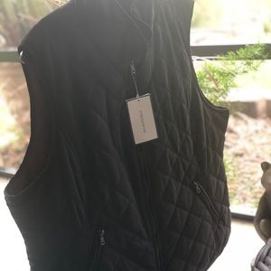 This reversible vest is size XXL and made by Bass.